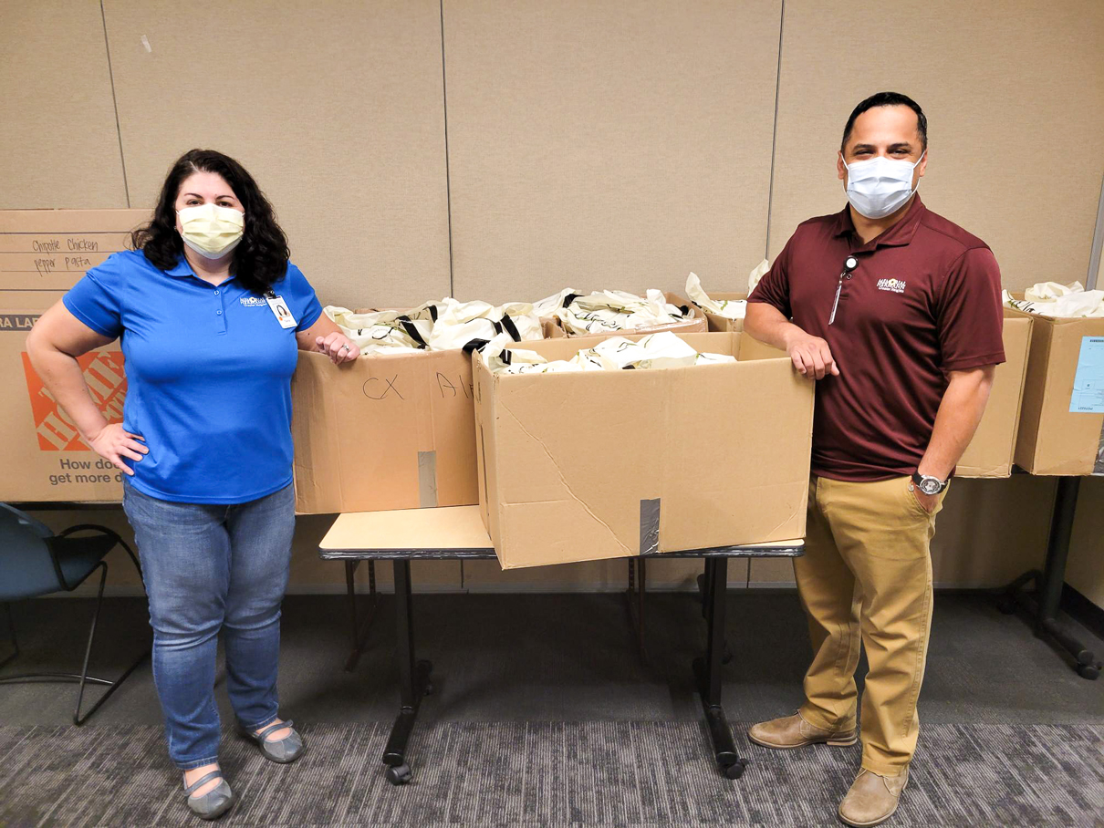 Memorial Hermann's team receives meals from Black Walnut Cafe for the Feeding Frontline Families initiative.